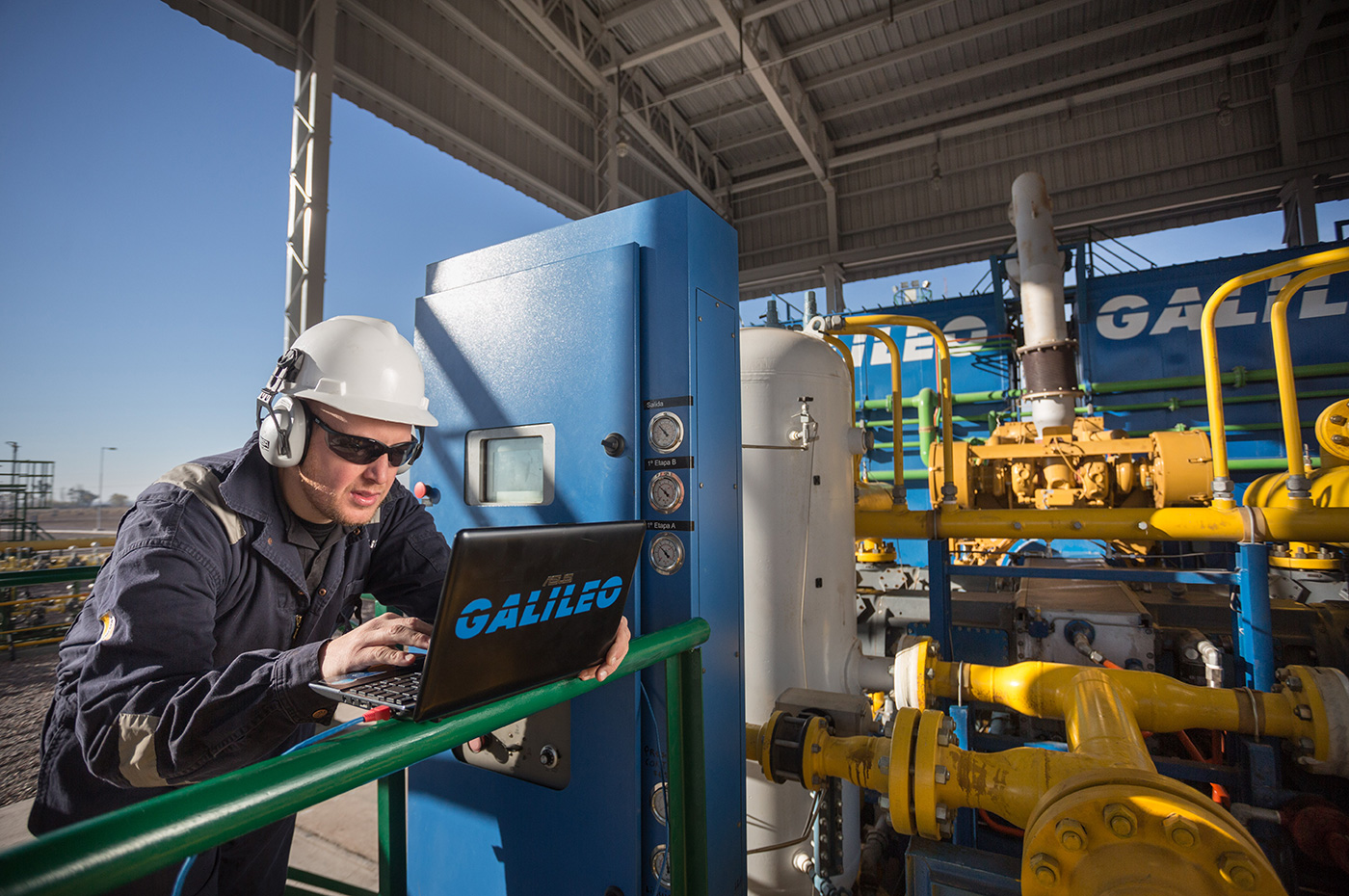 Galileo's Field Services personnel monitoring performance of Microskid Process compressor  packages in a mature well operated by YPF (Yacimientos Petroliferos Fiscales) in Loma de la Lata, Argentina.